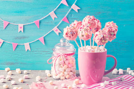 Pink cake pops in a teacup Stock Photo