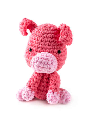 Crocheted amigurumi toy isolated on a white background