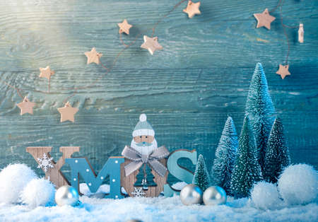 Christmas decoration on a green wooden background