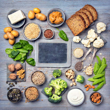 Vegan protein sources. Top view on a grey wooden background