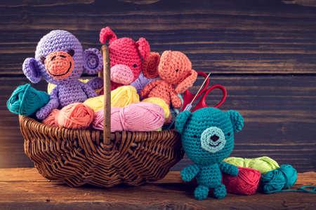 Amigurumi toys on a wooden background Stockfoto