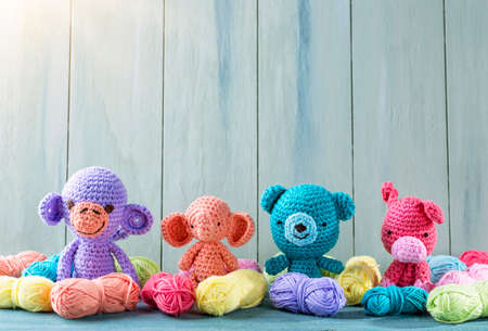 Amigurumi toys on a wooden background Stock Photo