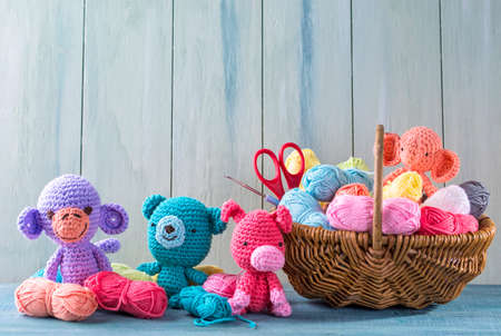 Amigurumi toys on a wooden background Stock fotó