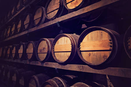 Wine cellar with a row of barrels, Austria Imagens