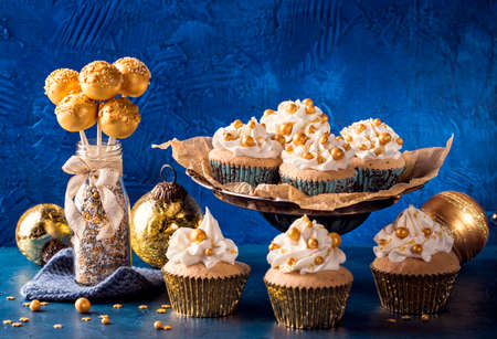 Golden sweets for christmas on a blue background