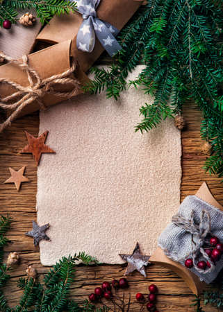 Old parchment for your wishes on a wooden background Banco de Imagens