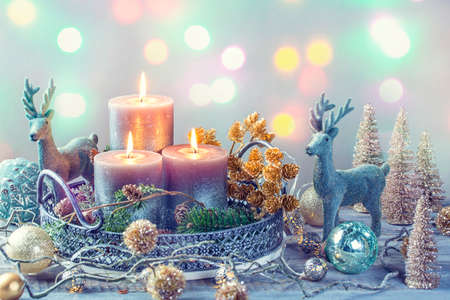 Candles and christmas decoration on a wooden background