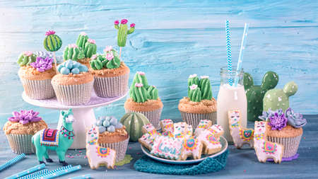 Cactus and llama sweets for children party Stock Photo
