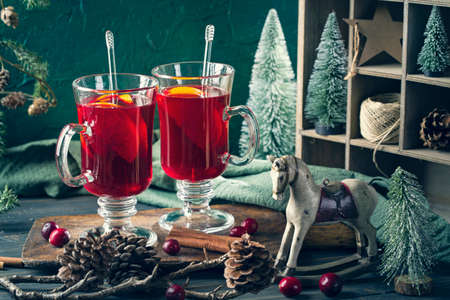 Winter hot drink with oranges and cranberries