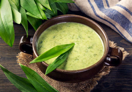 Ramsons cream soup in a white bowl