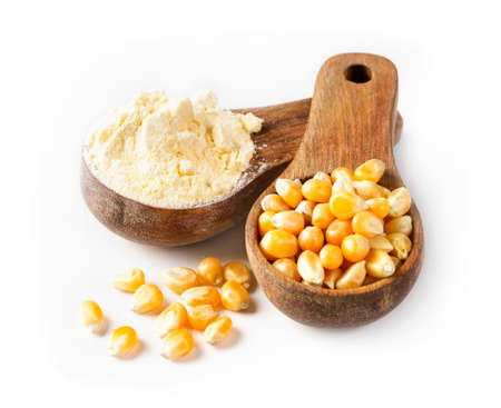 Corn flour in a wooden spoon isilated on a wooden background Standard-Bild