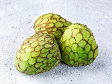 Cherimoya fruitson a grey background