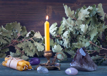 Handmade natural beeswax candles on a wooden background
