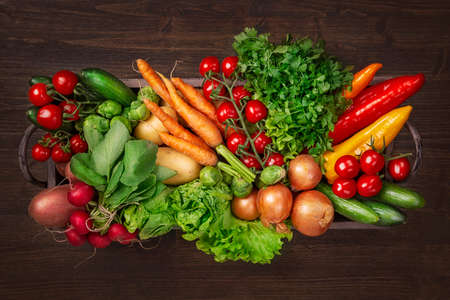 Vegetables in box on wooden background