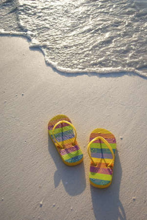 flipflops: A pair of colourful flip-flops at the water Stock Photo