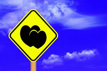 Road sign with Hearts, blue sky