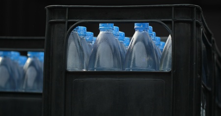 Plastic bottles filled with drinking water  Stock Photo - 17725336