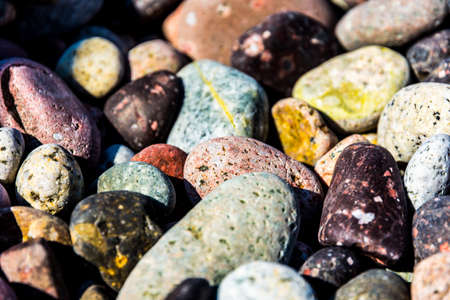 Colorful smalll pebbles on Corsica beach