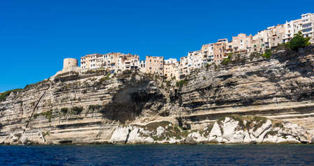 Landscape of Bonifacio city, Corsica. Buildings and houses on cliff from sea view. Stock Photo