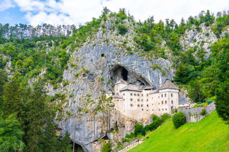 Predjama castle, Slovenia. Scenic view of Predjama castle near Postojna cave mouth. Anciend architecture builded in the rock. Old medieval fortress at sunny summer day