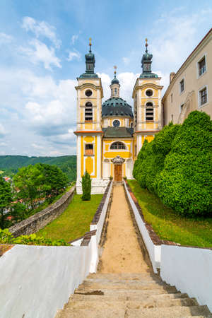 View of beautiful castle Vranov nad Dyji, Moravian region in Czech republic. Ancient chateau built in baroque style, placed on big rock above river near the Vranov village. Cloudy weather