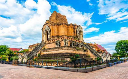 Wat Chedi Luang temple, Chiang Mai city, Thailand. View of big ancient ruin of breathtaking temple placed in the center of city. Sacred place of buddhism, spiritual and religion shrine.