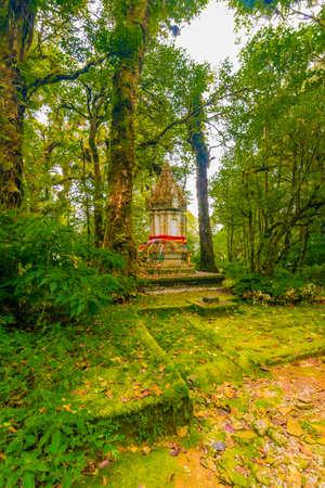 Memorial shrine at Doi Inthanon tropical rainforest park. Elephant statues on the sides as memento of king visit. Reklamní fotografie