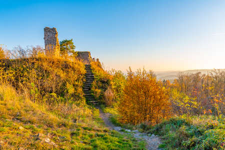 Ruin of castle Zubstejn standing on hill, Czech Republic. Castle built in 13 th century. Autumn day during the sunset. One of biggest ruins in Czechia. Also known as Zuberstein or Zubstein.