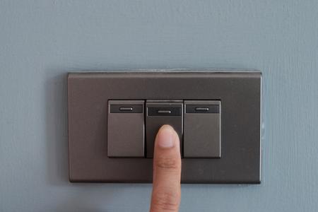 Black switch with a finger. Archivio Fotografico