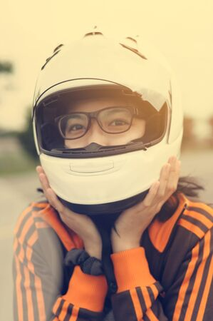 safety gear: Asian girl happiness is her vacation by riding her motorcycle and good safety gear such as the helmet to somewhere in the world.