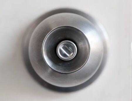 door knob: A door knob with a white door.