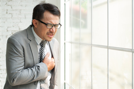 Businessman be ill and heart failure when he work hards always at his offiice.