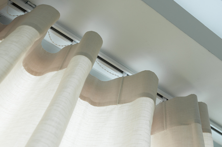 Close up of curtain  with curtain rails.