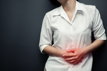 Closeup of asian woman hands having stomachache. Menstruation of women. Concept of a  woman need to go to the toilet. Asian woman be ill. copy space.