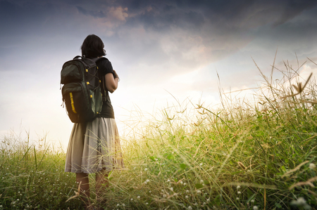 attempt: Concept of challenge, success, victory, struggle. Journey woman standing in nature with sunlight. Stock Photo