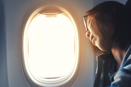 Asian woman sleeping in the airplane. Copy space.