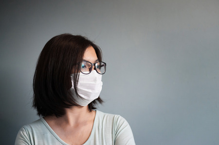 Asian glasses woman wear medical mask with copy space.