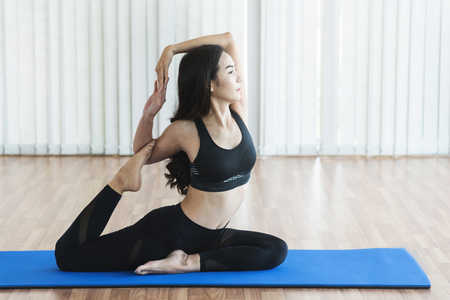 Young Asian woman practicing yoga. Copy space. Stock Photo