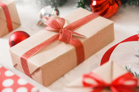 Brown present box with red ribbon for Christmas and New year. Stock Photo