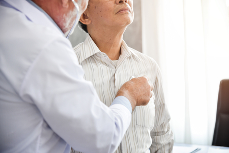 Senior Doctor is examining An Asian patient with stethoscope. Medical and health concepts. Lung, Cancer, pneumonia. Stockfoto