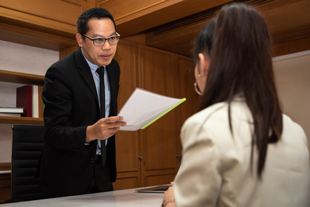 Asian Businessman arguing about works in a meeting.