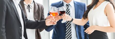 Cheers! Cropped Image of Business People Celebration Toast with red wine after meeting. Multiethnic Celebrating. Фото со стока