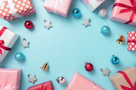 Top view of colorful gift boxes with decorations on blue background with copy space. Christmas, Birthday and New year concept. Banco de Imagens