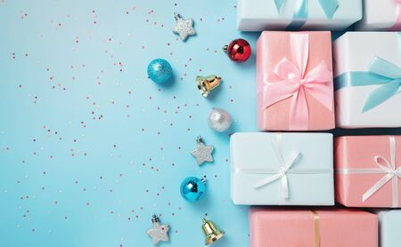 Top view of Pink and blue gift boxes on blue isolated background with copy space. Christmas, Birthday and New year concept.