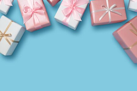 Gift boxes on blue isolated background with copy space. Christmas, Birthday and New year concept. Reklamní fotografie