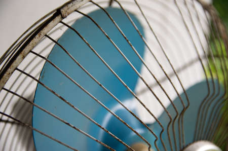 Vintage white stand fan with blue blades