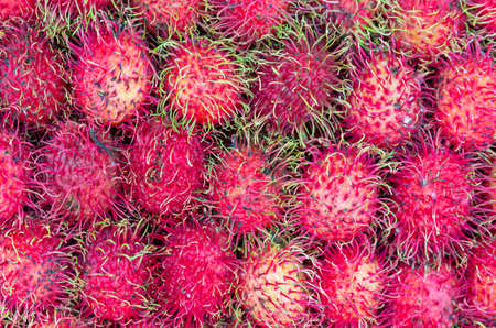Bunch of rambutan fruits (nephelium lappaceum) - close up