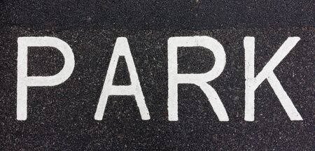 Parking sign painted on the road with white paint photo
