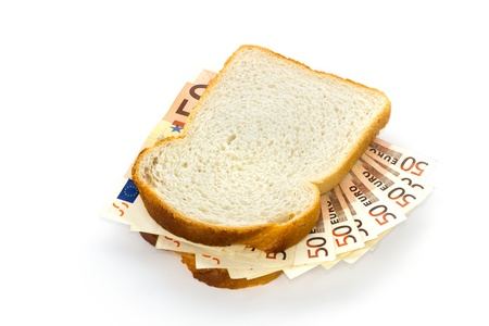 Slices of white bread with 50 euro bills sandwich filling photo