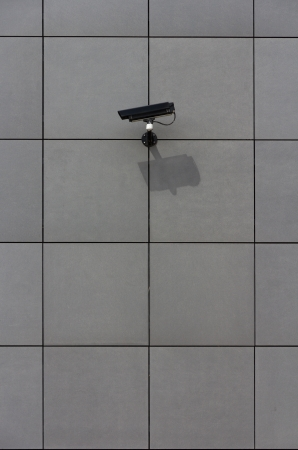 Big brother  Surveillance camera on tiled wall, aimed at his target photo